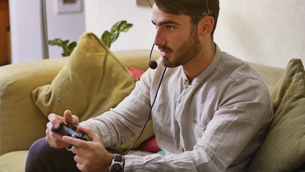 Man playing video games with ultra-low latency headset