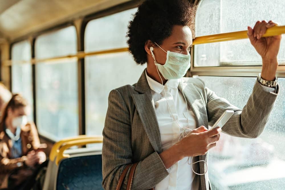 Woman wearing mask on public bus