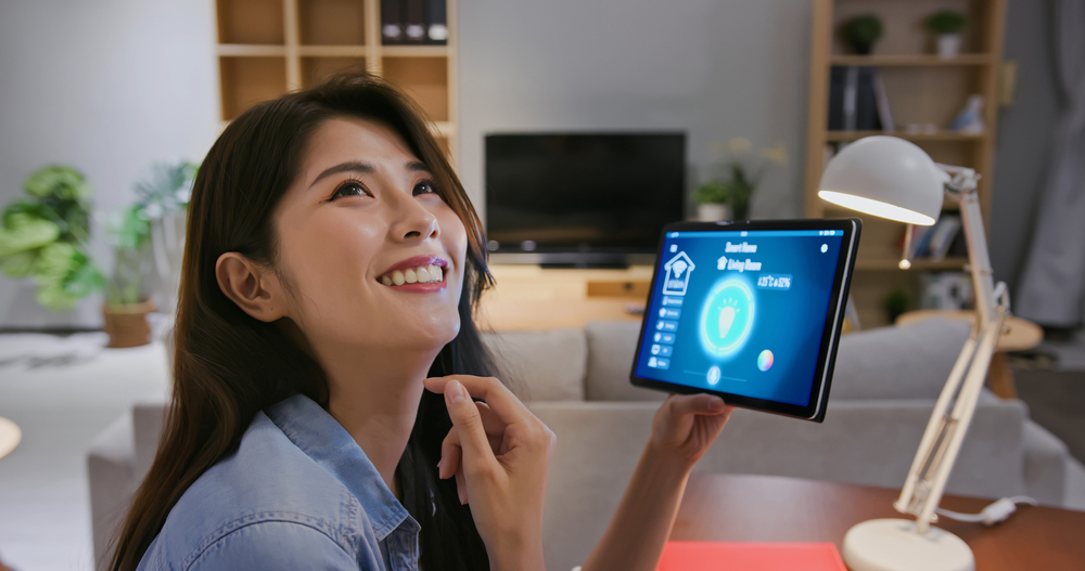 Woman with tablet smiling